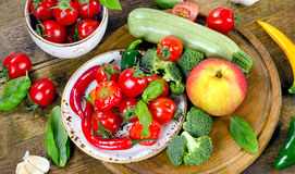 Healthy food background. Different vegetables on wooden table. Stock Photos