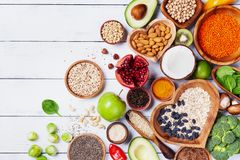 Free Healthy Food Background From Fruits, Vegetables, Cereal, Nuts And Superfood. Dietary And Balanced Vegetarian Eating Products Royalty Free Stock Image - 143677456