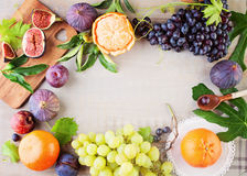 Healthy Food Background with Fruit, Berries, Wooden Board Stock Photo