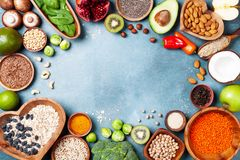 Healthy food background from fruits, vegetables, cereal, nuts and superfood. Dietary and balanced vegetarian eating products