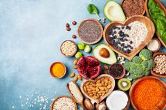 Healthy food background from fruits, vegetables, cereal, nuts and superfood. Dietary and balanced vegetarian eating products. On kitchen table top view royalty free stock photos