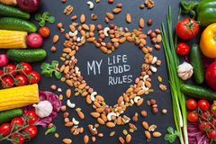 Healthy food background. Healthy food concept with fresh vegetables for cooking  and some kind types of nuts. The phrase `My life, Royalty Free Stock Photos