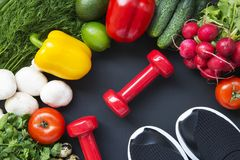 Healthy food background. Ingredients for cooking. Top view. Copy space. Dark background. Fitness diet. royalty free stock image