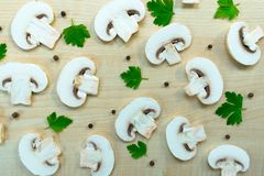 Healthy food background. Mushrooms champignon and parsley. royalty free stock images