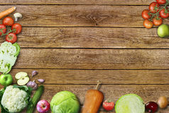 Healthy food background / studio photo of different fruits and vegetables on old wooden table royalty free stock photo