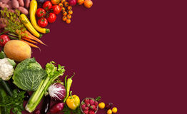 Healthy food background. Studio photo of different fruits and vegetables on red backdrop Royalty Free Stock Image