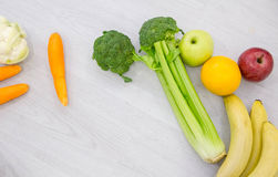 Healthy food background studio photo of different fruits and vegetables on wooden table stock photography