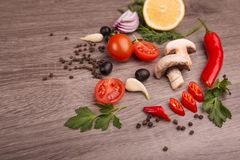 Healthy food background / studio photo of different fruits and vegetables on wooden table. Royalty Free Stock Photo