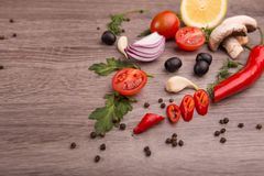 Healthy food background / studio photo of different fruits and vegetables on wooden table. Stock Photos