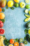 Healthy food background: Top view of different selected juicy organic tropical fruits. Top view of different selected juicy organic tropical fruits, superfood royalty free stock images
