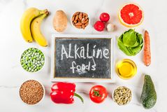 Alkaline diet ingredients. Healthy food background, trendy Alkaline diet products - fruits, vegetables, cereals, nuts. oils, white marble background above copy Royalty Free Stock Photos