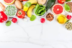 Alkaline diet ingredients. Healthy food background, trendy Alkaline diet products - fruits, vegetables, cereals, nuts. oils, white marble background above copy Stock Photography