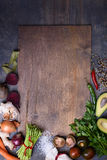 Healthy food background on wooden board. Vegetable menu. Top view, copy space. Stock Image