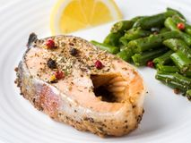 Healthy food. Baked red fish, pink salmon, salmon and green beans with a slice of lemon on a plate. Healthy food. Baked red fish, pink salmon, salmon and green stock images