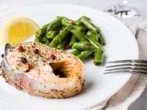 Healthy food. Baked red fish, pink salmon, salmon and green beans with a slice of lemon on a plate. Healthy food. Baked red fish, pink salmon, salmon and green royalty free stock photos