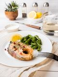 Healthy food. Baked red fish, pink salmon, salmon and green beans with a slice of lemon on a plate. Healthy food. Baked red fish, pink salmon, salmon and green royalty free stock photo