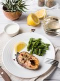 Healthy food. Baked red fish, pink salmon, salmon and green beans with a slice of lemon on a plate. Healthy food. Baked red fish, pink salmon, salmon and green stock photo
