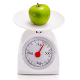 Healthy food on balance scale Royalty Free Stock Photos