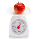 Healthy food on balance scale Stock Photography