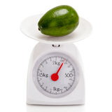 Healthy food on balance scale Royalty Free Stock Images
