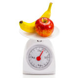 Healthy food on balance scale Stock Images