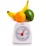 Healthy food on balance scale Royalty Free Stock Image