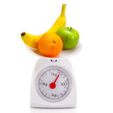 Healthy food on balance scale Stock Photos
