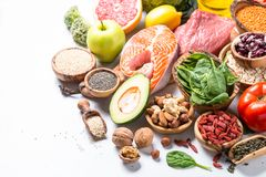 Healthy food - Meat, fish, legumes, nuts, seeds and vegetables. Healthy food balanced nutrition. Meat, fish, legumes, nuts seeds greens and vegetables stock photo