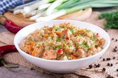 Healthy food. Barley porridge with meat and vegetables. Healthy food. Barley porridge with meat and vegetables on a wooden background stock photography