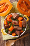 Healthy food: Beef stew with pumpkin and spices closeup. Vertica Royalty Free Stock Photo