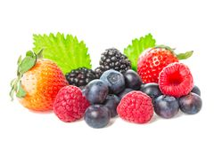Healthy food berries group. Macro shot of fresh raspberries, blueberries, blackberries and strawberry with leaves isolated on whit. E background Stock Photography
