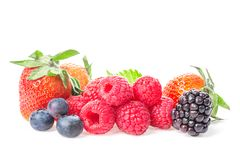 Healthy food berries group. Macro shot of fresh raspberries, blueberries, blackberries and strawberry with leaves isolated on whit. E background Royalty Free Stock Photography