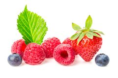 Healthy food berries group. Macro shot of fresh raspberries, blueberries and strawberry with leaves isolated on white background. Healthy food berries group Royalty Free Stock Photos