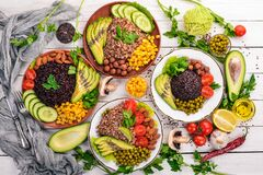 Free Healthy Food. Black Rice, Buckwheat, Avocado, Cherry Tomatoes, Green Peas And Hazelnut. On A Wooden Background. Stock Photo - 173923730