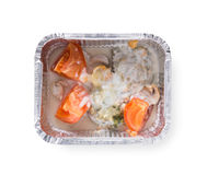 Healthy food in boxes, diet concept. Meat in white souce, mushrooms and tomato. Healthy lunch in foil container. Healthy food take away and delivery. Meat in Stock Images