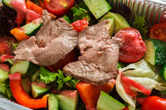 Healthy food in boxes, diet concept. Steamed beef with vegetables Stock Image