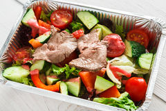 Healthy food in boxes, diet concept. Steamed beef with vegetables Royalty Free Stock Images