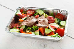 Healthy food in boxes, diet concept. Steamed beef with vegetables Stock Photo