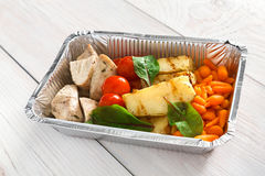 Healthy food in boxes, diet concept. Steamed turkey with vegetables Stock Image