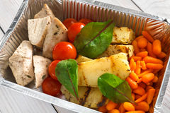 Healthy food in boxes, diet concept. Steamed turkey with vegetables Royalty Free Stock Photos