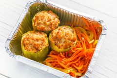 Healthy food in boxes, diet concept. Stuffed zucchini. Healthy food delivery closeup diet concept. Take away of fitness meal. Weight loss lunch in foil boxes Royalty Free Stock Photos