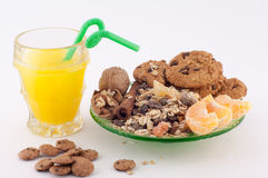 Healthy Food. Healthy breakfast of oatmeal, cinnamon, cookies and a glass of orange juice on a white background stock image