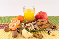 Healthy Food. Healthy breakfast of oatmeal, cinnamon, fruit, cookies and a glass of orange juice on a white background stock photography
