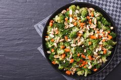 Healthy food: Broccoli salad with peanuts horizontal top view Stock Images
