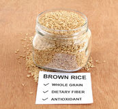 Healthy Food Brown Rice in a Bottle Royalty Free Stock Photography