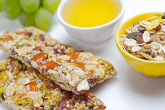 Healthy food. Cereal bars, grapes, honey as a healthy food Royalty Free Stock Images
