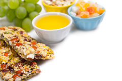 Healthy food. Cereal bars, grapes, honey as a healthy food Royalty Free Stock Photography