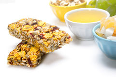 Healthy food. Cereal bars, grapes, honey as a healthy food Stock Photos
