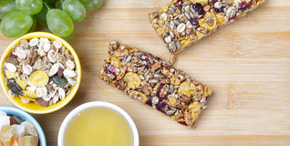 Healthy food. Cereal bars, grapes, honey as a healthy food Stock Images