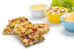 Healthy food. Cereal bars, grapes, honey as a healthy food Royalty Free Stock Image